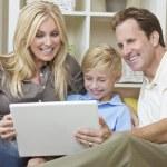 Happy Family Sitting on Sofa Using Laptop Computer — Stock Photo