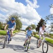 Young Family Parents and Boy Son Cycling — Stock Photo