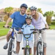 Young Family Parents and Boy Son Cycling — Stock Photo #11458037