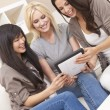 Royalty-Free Stock Photo: Three Beautiful Women Friends Using Tablet Computer