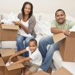 African American Family Unpacking Boxes Moving House — Stock Photo #11458308