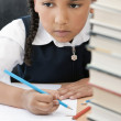 African American School Girl Writing In Class — Stock Photo