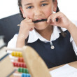 African American School Girl In Class Writing & Abacus - Stock Photo