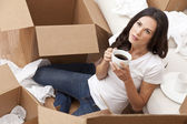 Woman Drinking Coffee Unpacking Boxes Moving House — Stock Photo