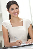 Hispanic Latina Woman or Businesswoman in Office Writing — Stock Photo