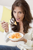 Brunette Woman Eating Melon At Home on Sofa — Stock Photo