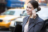 Young Woman Talking on Cell Phone by Yellow Taxi — Stock Photo