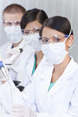 Team of Scientists With Test Tubes In Laboratory — Stock Photo