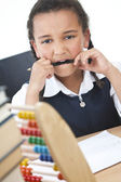 African American School Girl In Class Writing & Abacus — Stock Photo
