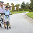 Royalty-Free Stock Photo: Woman and Boy Child, Mother & Son Cycling