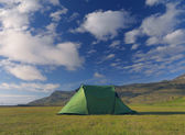 Camping tent in the open field in horizontal format — Stock Photo