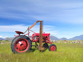 Old red abandoned tractor side profile — Stok fotoğraf