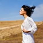 Portrait sensuality brunette girl over sand background — Stock Photo #10820518