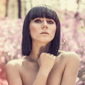 Portrait of a sensual girl in the forest — Stock Photo