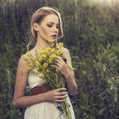 Beautiful girl in a wild forest — Stock Photo