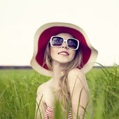 Romantic portrait of a girl in a hat — Stock Photo