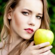 Sensual portrait of a girl with an apple — Stock Photo