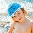 Portrait of cute little girl on beach vacation — Stock Photo