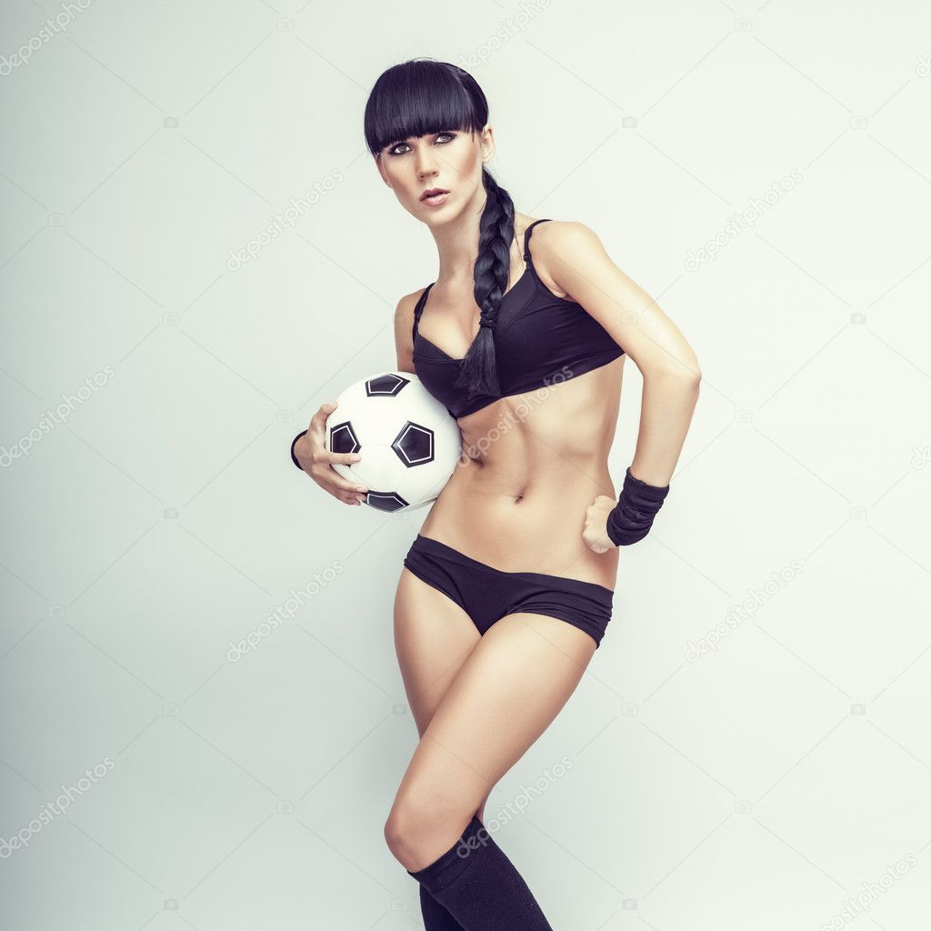 Sporty young woman with a ball — Stock Photo #11695775