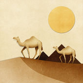 Camel and pyramid on desert Recycled Paper craft — Stok fotoğraf