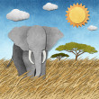 Elephant in Safari field recycled paper background - Stock Photo