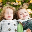 Happy children lying outdoors — Stockfoto #10909792