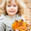 Child in autumn — Stock Photo #10909818