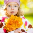 Stock Photo: Girl with yellow leaves