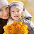 Happy family in autumn park — Stock Photo #10909869