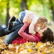 Woman with child having fun in autumn park — Stock fotografie #10909874