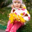 Child with bunch of yellow leaves — Foto Stock