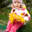 Child with bunch of yellow leaves — Stok fotoğraf