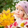 Child with bunch of autumn leaves — Stok fotoğraf