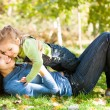 Woman with child having fun in autumn park — Stock Photo #10909916