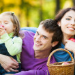 Family having picnic in park — Stock Photo #10909932