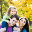 Family playing in autumn — Stock Photo #10909953