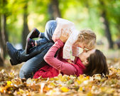 Woman with child having fun in autumn park — Stok fotoğraf