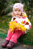 Child with bunch of yellow leaves — Foto de Stock