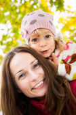 Woman with child in autumn — Foto Stock