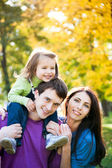 Family playing in autumn — Stock Photo