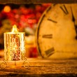 Stock Photo: Christmas candle and vintage ckock
