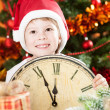 Kid in Santa's hat holding vintage clock — Stock Photo #11888934