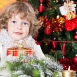 Happy child holding gift — Stock Photo #11889053