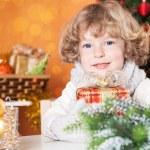 Happy child holding present — Stock Photo #11889058