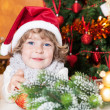 Happy child in Santa hat — Stock Photo
