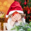 Happy child holding Christmas ball — Stock Photo
