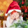 Happy child holding Christmas ball — Stock Photo