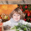 Happy child looking into wooden frame — Stock Photo