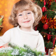Happy child on the Christmas eve — Stockfoto