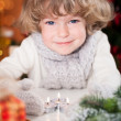 Smiling child with Christmas candles — Stock Photo #11889227